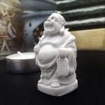 Miniature Buddha with peacock feather