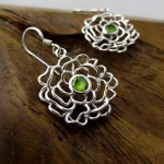 Silver hook earring with Peridot centre