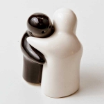 Hugging salt and pepper shakers