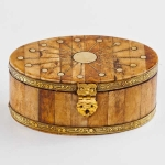 Oval wooden trinket box with sun design