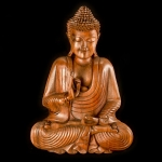 Traditional carved wooden meditating Buddha
