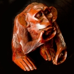 'Thinker' carved wooden monkey