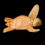 Carved wooden swimming turtle