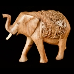 Blanketed elephant wood carving