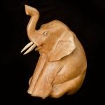 Sitting elephant wood carving